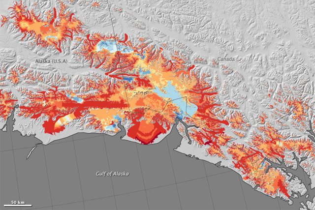 This map shows changes to glaciers between 1994 and 2013 in southern Alaska's Wrangell and St. Elias mountain ranges. Specifically, the map shows the region's mass balance — the difference between the ice each glacier has gained and lost each year. The change is shown in meters of meltwater equivalent; that is, the depth of water that would result if that ice were melted. In general, red colors show where glaciers have thinned, and blue colors are where they have thickened. Graphic: Jesse Allen, Anthony Arendt (University of Washington), and Chris Larsen (University of Alaska, Fairbanks)