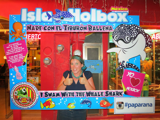 Posing with the whale shark sign in town.