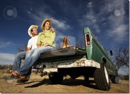 cutcaster-photo-100221903-Cowboy-and-woman-on-pickup-truck