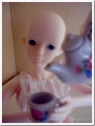 Behind the Scenes Photo of Having Tea with a Doll