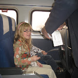 Hannah having her ticket stamped by the Amtrak train conductor on our way to Chicago 01142012