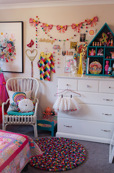 Rainbow Girls Room Decor Interior Wall Art Helen Dardik Rhapsody and Thread Liberty Bow Garland Felt Ball Garland Rug Little Rosie and Me Arlo and Co Mirror Little Puddles Liberty Cloud Heart Banner Laura Blythman Toucan Print