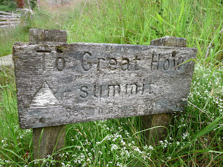 A worn sign showing the way to Great How.