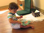 """In our infant room, children have free access to a selection of books. They love to """"read"""" on their own, and, of course, their Montessori teachers also read to them regularly."""