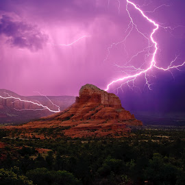Purple Lightning around the Red Rocks by Steven Love - Digital Art Places ( clouds, courthouse butte, famous, mountain, hdr, purple, sandstone, bell rock, high dynamic range, landscape, dangerous, photo, manipulation, composite, amazing, lightning, red, arizona, composition, sedona, rain, formation )