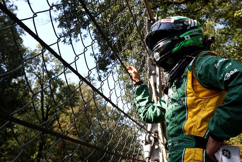 Хейкки Ковалайнен за забором на Гран-при Италии 2011