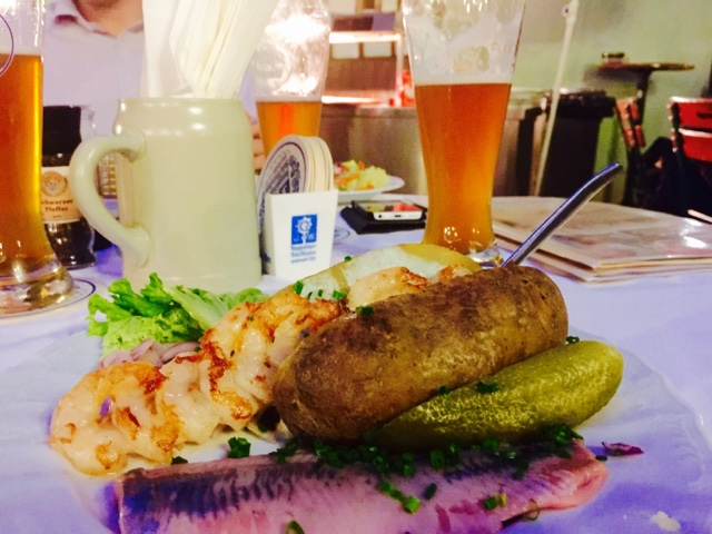 White herring, potato, scampi and gherkin in Zum Augustiner in Munich