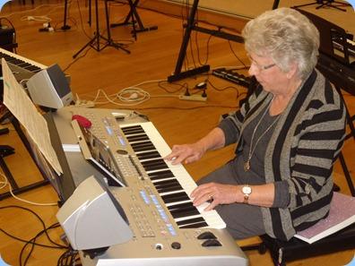Barbara Powell playing the Yamaha Tyros 4.