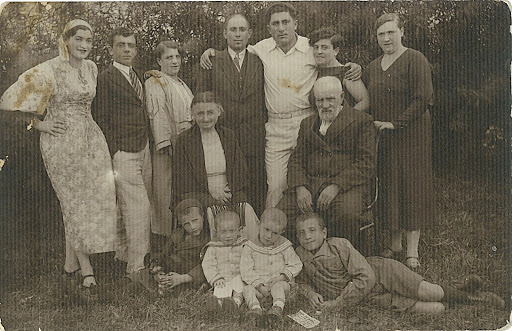 Shown are Standing from left to right :  Eva (Chava) Kaminska-Etkin, my father's uncle Hanoch (Chonke) Etkin,his wife(name unknown), Chanan Pirivoskin (husband of my father's aunt Rachel Etkin), Bomma Kabakov - a cousin, who came from Israel to visit the family in Krulevshchizna, my father's aunt Rachel Etkin, and one more unknown family relative. Sitting :  My father's grandparents:   Chaya-Liebe Kabakov and Shaul-Rafael Etkin, . At the bottom, from left to right:  Mike (Zelik) Hodosh - my father's cousin, my father - Michael (Mishka) Etkin, his twin brother - Chaim-Shepse (Shepsele) Etkin, and Greg (Hirshel) Hodosh - my father's cousin (Mike's brother). submitted by Menachem Etkin
