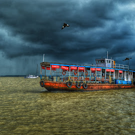 The Clouds by Uttam Das - Transportation Boats ( clouds, weather, seascape, boat, rain,  )