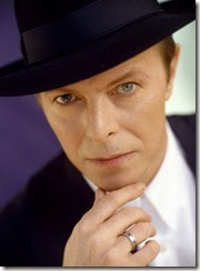 67596-actor-navy-blue-hat-david-bowie-serious-face-green-eyes-300x410
