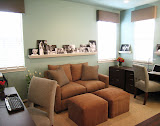 Bridgeport Home Office - A wood moulding was placed around the room so that the clients can display their family photos. This office has two work stations and a comfortable loveseat and ottoman and TV for relaxing.