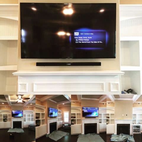 TV Mounted Over Fireplace With Sound Bar Floating Under It.