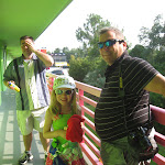 Jeff, putting on sunscreen, Hannah and Grampa Anthony at the All Star Music resort in Disney 06062011