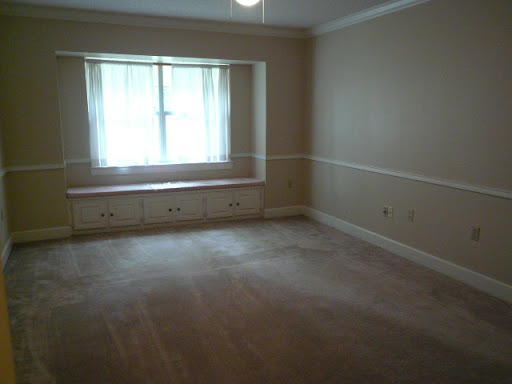 Bedroom 4 -  Built-in window seats and storage, walk-in closet, ceiling fan, intercom, chair rails and crown molding.