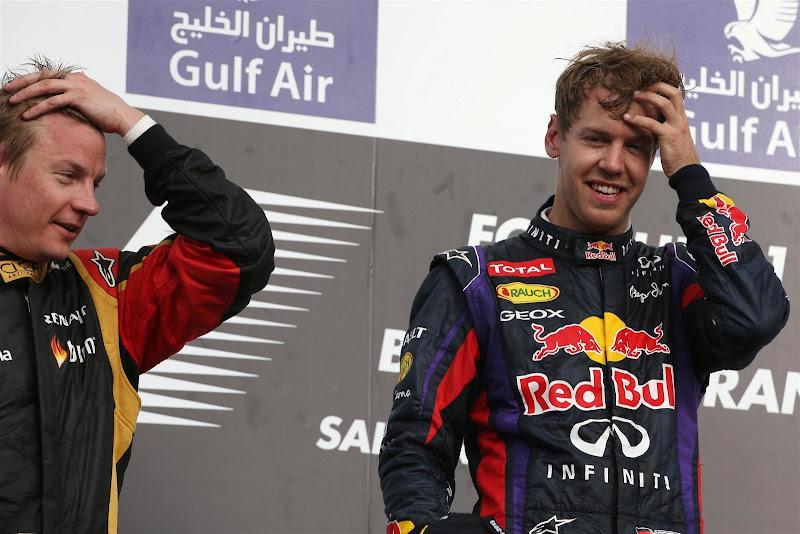 Кими Райкконен и Себастьян Феттель держатся за головы на подиуме Гран-при Бахрейна 2013
