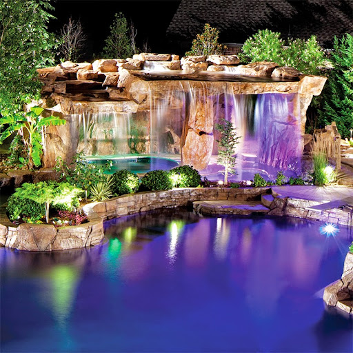 Blue Haven Pools created a natural-style design with a stacked stone waterfall, raindrop style sprayer, and combination fountain shelf/tanning ledge