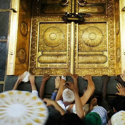 Muslim pilgrims are drawn to touch the golden door of the Kaaba during traversal of the Great Mosque in Mecca in the morning on November 9..jpg