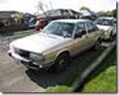 120px-1981_Audi_100_5ECD_%252B_camera_strap_(9207883090)