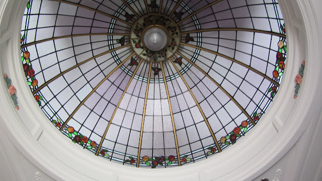 A beautiful glass dome ceiling inside one of the Art Deco buildings.