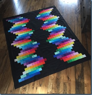 Wiggle me quilt with black background.