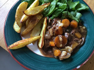 rationing Curried potato wedges; leftover brisket with gravy & veg; spinach