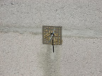 CLose-up of wall tack & glue