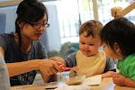 LePort Private School Irvine - Montessori teacher helping baby self-feed