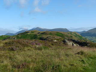 Skiddaw shows itself above the top of High Rigg.
