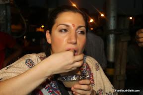 Eating Spicy Golgappa http://foodtourindelhi.com http://indiafoodtour.com
