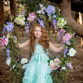 Wonderland by Carole Brown - Babies & Children Child Portraits ( little girl, red hair, floral swing, trees, blue eyes, mint dress )