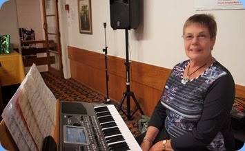Pam Rea posing for the photo shoot before delivering some wonderful arrangements on her lovely Korg Pa900 keyboard. Pam always finds great melodic songs that we know but don't hear very often - wonderful! Photo courtesy of Club Photograher, Dennis Lyons.