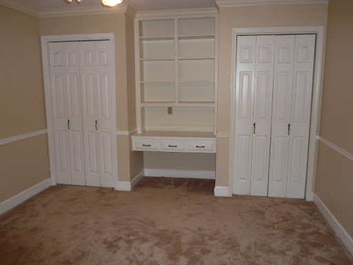 Bedroom 3 w/ built-in bookcase and desk, double closets, ceiling fan, intercom, crown molding and chair rails.