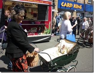 8 costumed 40s lady and pram