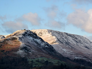 Helm Crag and Steel Fell covered with snow. At least the sun is shining.