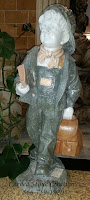 Boy W/ Book Bag Mixed Marble - Primarily Verde Oliva.
