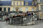 Almost all of us posing on the steps of Fontainebleau palace