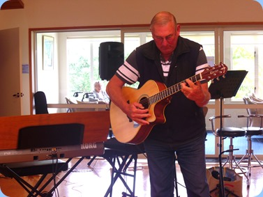 Kevin Johnston accompanying the music on his Crafter acoustic guitar. Photo courtesy of Delyse Whorwood.