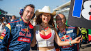 Scuderia Toro Rosso mechanics with a grid girl