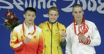 Gold Medallist Australia's Matthew Mitcham, center,, China's Liang Huo, silver, and bronze winner Russia's Gleb Galperin. right, pose with their medals at the end of the men's 10m platform diving competition at the Beijing 2008 Olympics in Beijing, Saturday, Aug. 23, 2008. (AP Photo/Sergey Ponomarev)