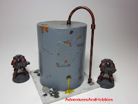 Battle damaged vertical storage tank Industrial Science Fiction war game terrain and scenery