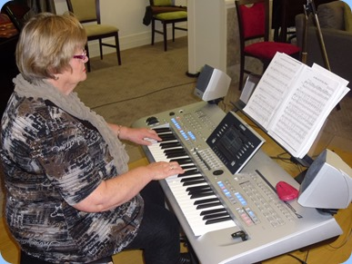Our host, Barbara McNab, playing her Yamaha Tyros 4.
