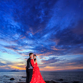 Red in Sunset by Fransiskus Chai - People Couples ( red, blue hour, sunset, couple, seascape )