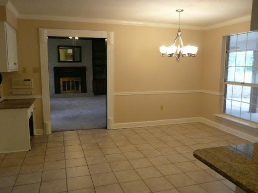 Kitchen - Eat-in area w/ master intercom controller, built-in desk w/ storage cabinet, chandelier, crown molding and chair rails.