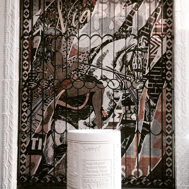 Mosaic and prayer wheel in the Faile Temple at Savage/Sacred Young Minds, Brooklyn Museum