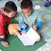 Racuni anak dengan buku untuk cerdas