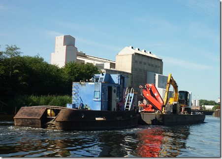 2 crt barge pushes digger