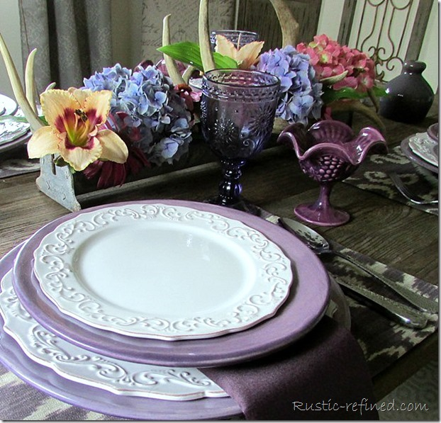 Purple & White Dishes on a rustic barn wood table makes a stunning tablescape