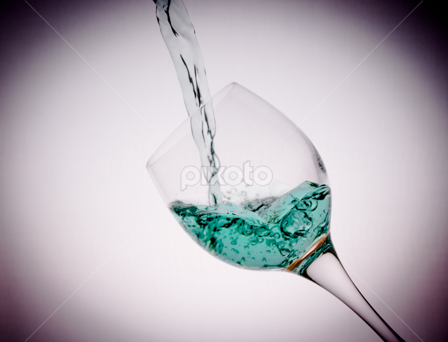 wine glass tilted with blue drink vignette by Kathy Dee - Food & Drink Alcohol & Drinks