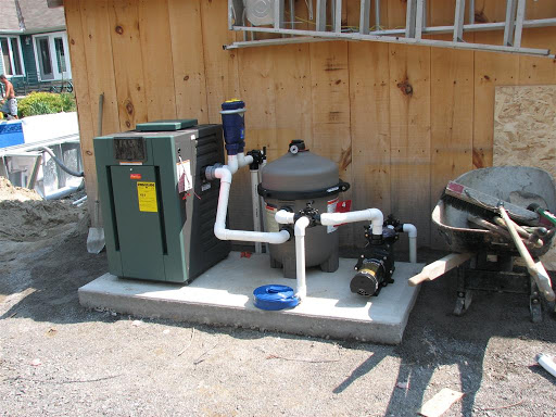 Here's the equipment...  <br />The heater on the left (Still needs to be tied to a propane tank)<br />The Salt water system (Blue unit)<br />The filter system (Big barrel)<br />The pool pump.<br /><br />I hope to bury the backwash line and run it back into the woods at some point.